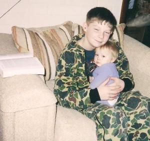 Shawn camo holding little Fiona