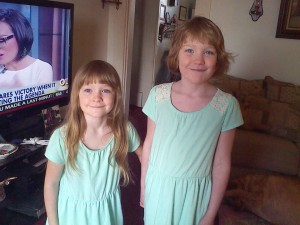 Emma and Abby in green dresses
