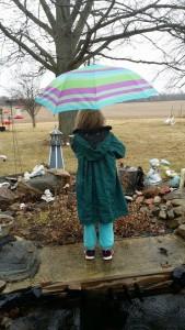 Emma and umbrella back